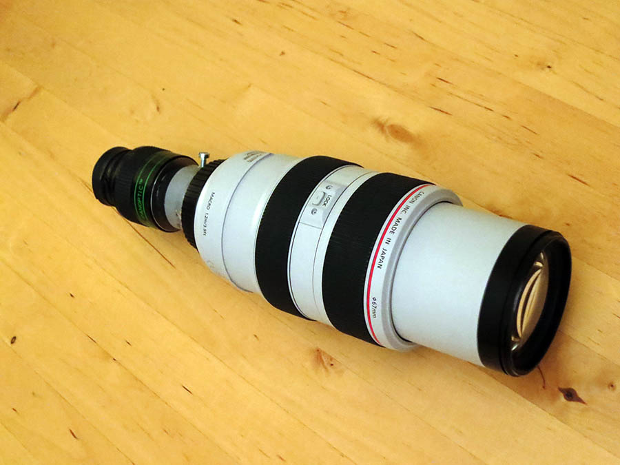 Use of a telephoto lens as a small telescope